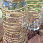 Update an Old Glass Container Using Spray Paint and Rubber Bands